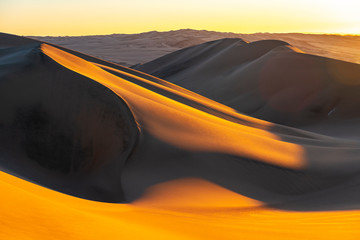 Sunset in the sand dunes and desert between Ica and Huacachina, Peru, South America.
