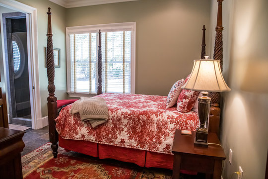 Red Toile formal guest bedroom with traditional decoration