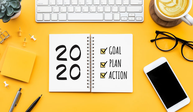 2020 new year goal,plan,action text on notepad with office accessories.Business motivation,inspiration concepts