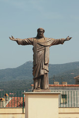Statue of Christ on pedestal. Propriano, Corsica, France