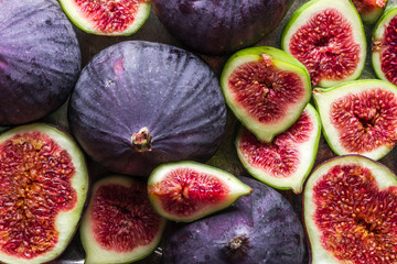 Background of figs. Fresh, juicy ripe fig fruits slices.