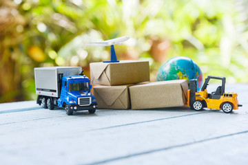 logistics transport import export shipping service Customers order things from via internet International shipping online Air courier Cargo plane boxes packaging freight forwarder to worldwid Fototapete