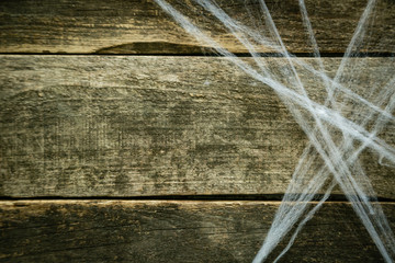 Halloween background - web on wood table, top view