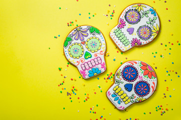 Dia de los muertos concept - skull shaped cookies with colorful decorations, top view