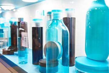 Showcase shop with plastic bottles shampoo