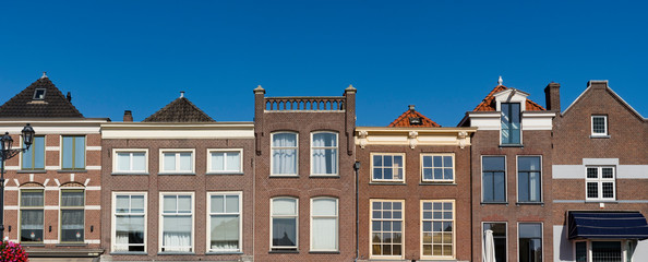 facade of houses on main square Markt in Delft, The Netherlands