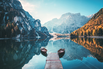 Spoed Fotobehang Natuur Boats on the Braies Lake ( Pragser Wildsee ) in Dolomites mountains, Sudtirol, Italy