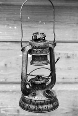 Old rusted red kerosene lamp