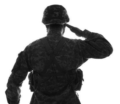 Silhouette of saluting soldier on white background, back view