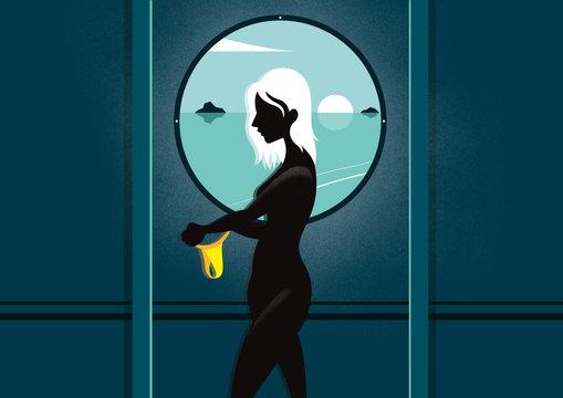 Woman holding yellow bikini bottom in boat