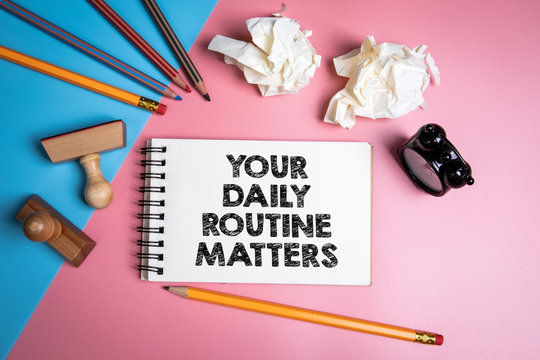 Your daily routine matters. Handwriitng text in the notebook