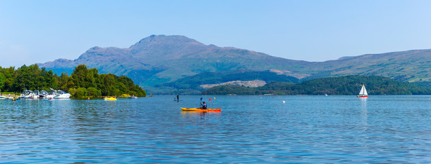 Luss at Loch Lomond, Scotland, 25 August 2019. People relaxing and having fun during one of the hot days in Summer.