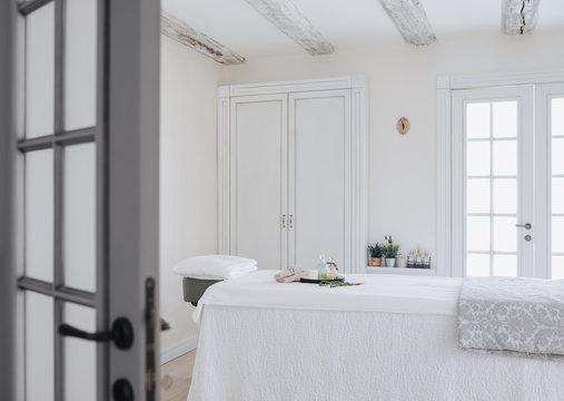 Massage table at luxury spa salon interior.