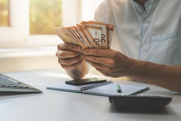 business success - businessman counting cash money in the office