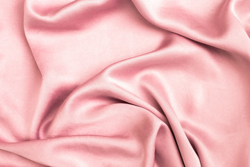 Abstract shiny pink satin fabric background, blank waving pink fabric background