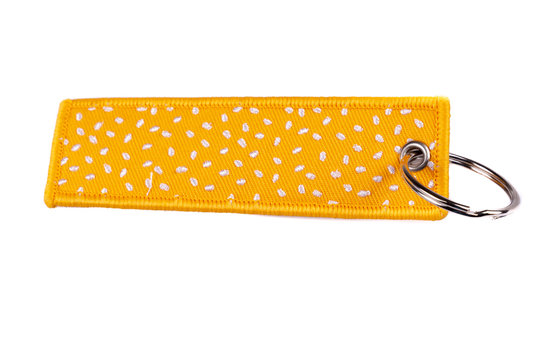 fabric key chain with yellow canvas on white background