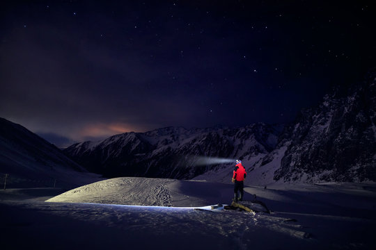 Man in mountains with night sky