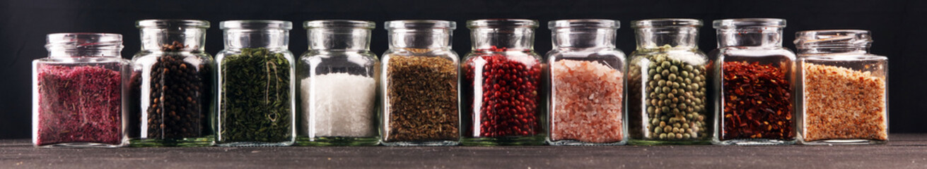assortment of spices in glass on table. Food and cuisine ingredients and peppers
