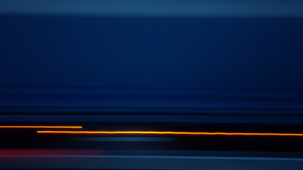 Long exposure, light painting Photo on the highway during the ride. Photographed from the side window of a car.
