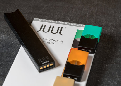 Box holding JUUL nicotine dispenser and pods