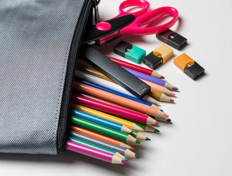 JUULpods and dispenser hidden inside pencil case