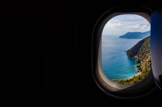 Italy looking out an airplanes porthole window during a flight , image using for sky and interior airplane concept