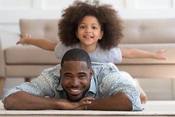 Happy african american joyful family of two portrait.