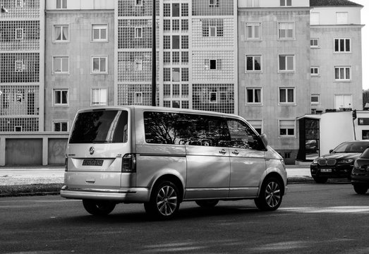 STRASBOURG, FRANCE - MAY 9, 2017: Side view of luxury Multivan TDI Caravelle business on French street - black and white