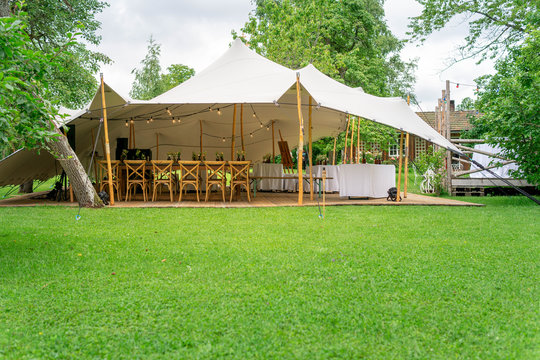 Image of huge tent for a wedding event in the nature
