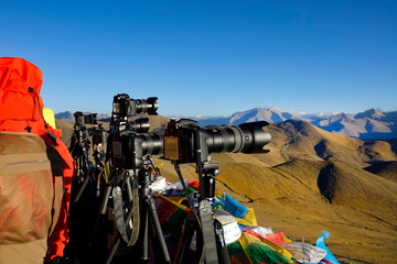 CLOSE UP Cameras are left at a viewpoint as tourists wait for sunset in Himalaya