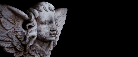 Fototapete - Death. Angel. Ancient statue isolated on black background. Pain, fear, the end of life concept.