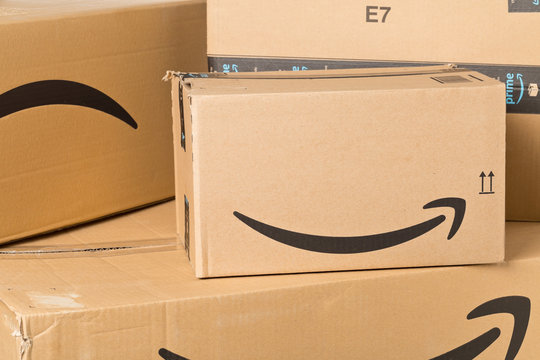 DRESDEN, GERMANY - APRIL 3, 2019 : Amazon logo on stack of delivered parcels