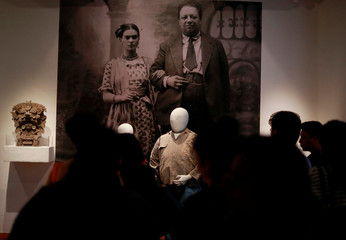 People look on during the presentation of the exhibition of paintings of Mexican muralist Diego Rivera and Mexican artist Frida Kahlo as part of the 25th anniversary of the Dolores Olmedo Museum in Mexico City
