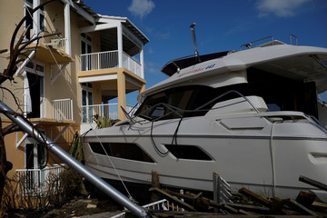 A destroyed boat is seen at a devastated hotel after Hurricane Dorian hit the Abaco Islands in Marsh Harbour