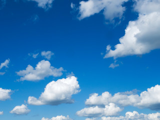 Beautiful blue sky with cumulus humilis clouds with flat bottoms and fluffy tops on a mostly sunny day.