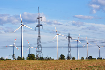Wind turbines and power lines behind an acre seen in Germany