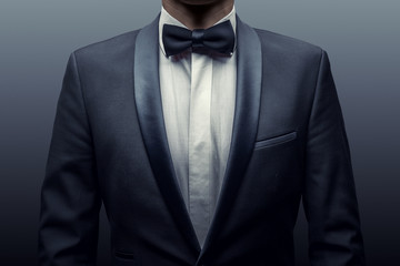 Business man in a suit and bow-tie Fotobehang
