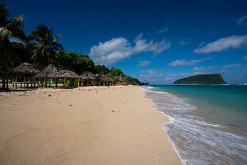 Beach fale's on a white sand beach on Lalomanu, Samoa