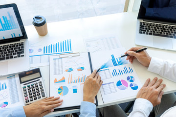 businessman in meeting analysis chart graphy
