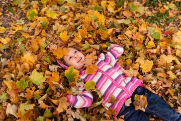 Girl child enjoying autumn season outdoors