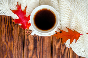 Autumn still life with cup of black coffee