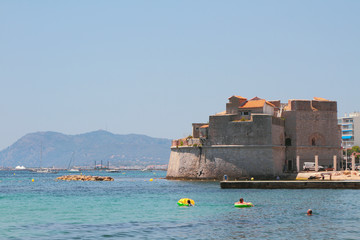 Beach and ancient fort on sea coast. Toulon, France