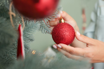 In de dag Bomen Woman decorating beautiful Christmas tree at home, closeup