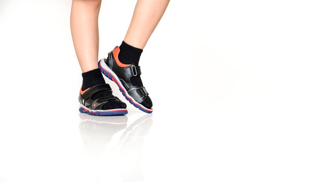 close up photo boy's legs in black sandals with socks