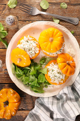 stuffed pumpkin with rice and salad, top view