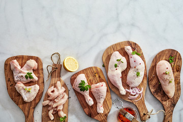Bottom border on marble with raw chicken portions