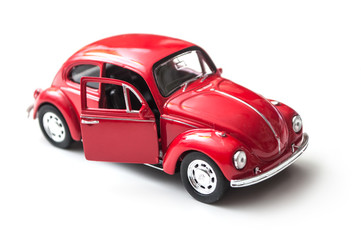 Mulhouse - France - 16 October 2018 - closeup of vintage red miniature volkswagen bettle  on white background