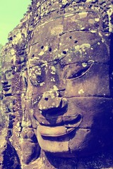 Wall Mural - Cambodia - Angkor temple face. Retro filtered colors style.