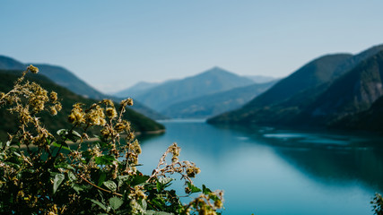Zhinvali reservoir lake landscape with mountains . The main Caucasus ridge.