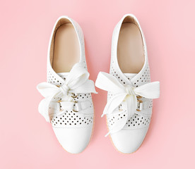 Pair white leather female sneackers with shoe lace,pair woman's shoes.